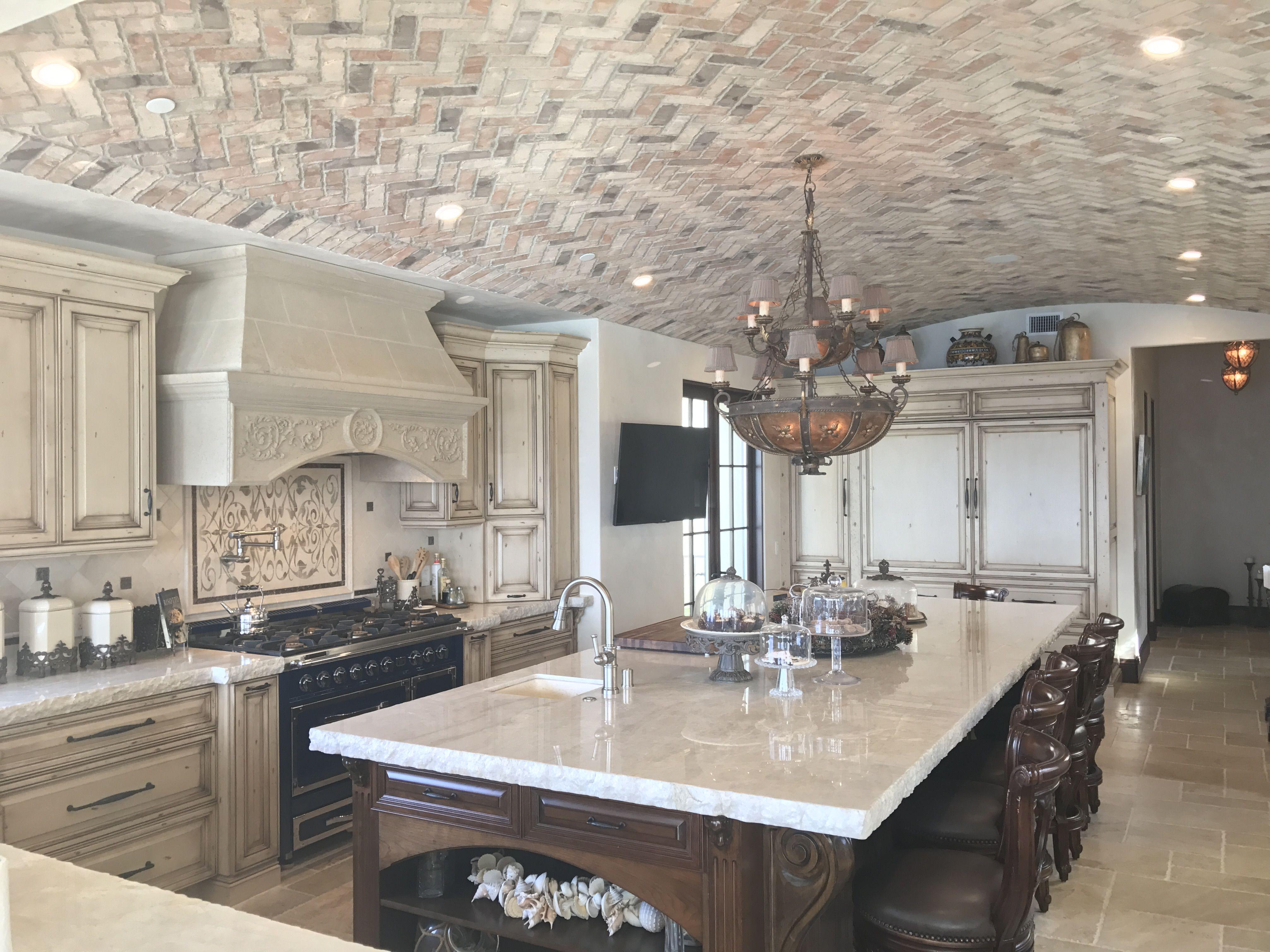 Kitchen with island stone hood herringbone brick ceiling custom