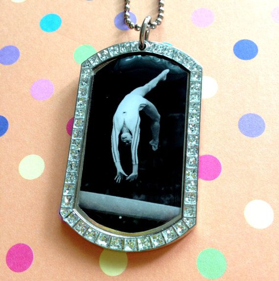 Nadia Comaneci Glitter Pendant Dog Tag Necklace, great gift for any gymnastics lover. $27.00, via Etsy.