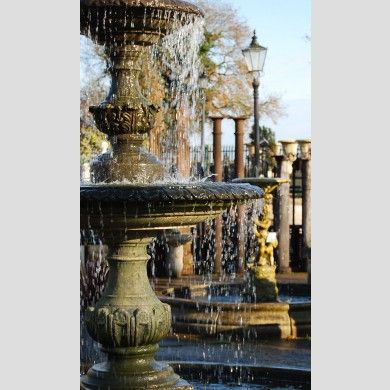 An+English+two+tier+composition+stone+fountain+and+decorative+circular+pool+surround