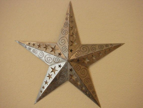 """Our Ornamental 3D Texas Star Metal Wall Art is cut from 16 gauge cold rolled steel and is pictured in polished silver, Copper Patina and Torch Patina. This piece is approximately 24"""" in diameter X 1""""D.  This piece is beautifully ground to bring out the shine in the metal. We added stars and """"wing-dings"""" to each leg of the star to give it a unique ornamental look."""
