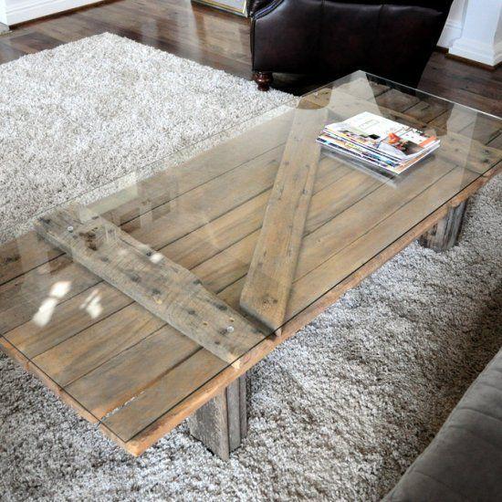 Barn door repurposed into a coffee table. Glass top