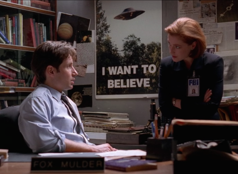 "Mulder and Scully doing their banter-y thing in the season five episode ""Bad Blood."" (Screenshot by Ella Morton) Object of Intrigue: The X-Files' 'I Want to Believe' Poster 