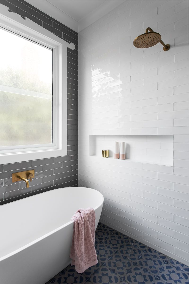 gray subway tiling in a serene pink   white bathroom