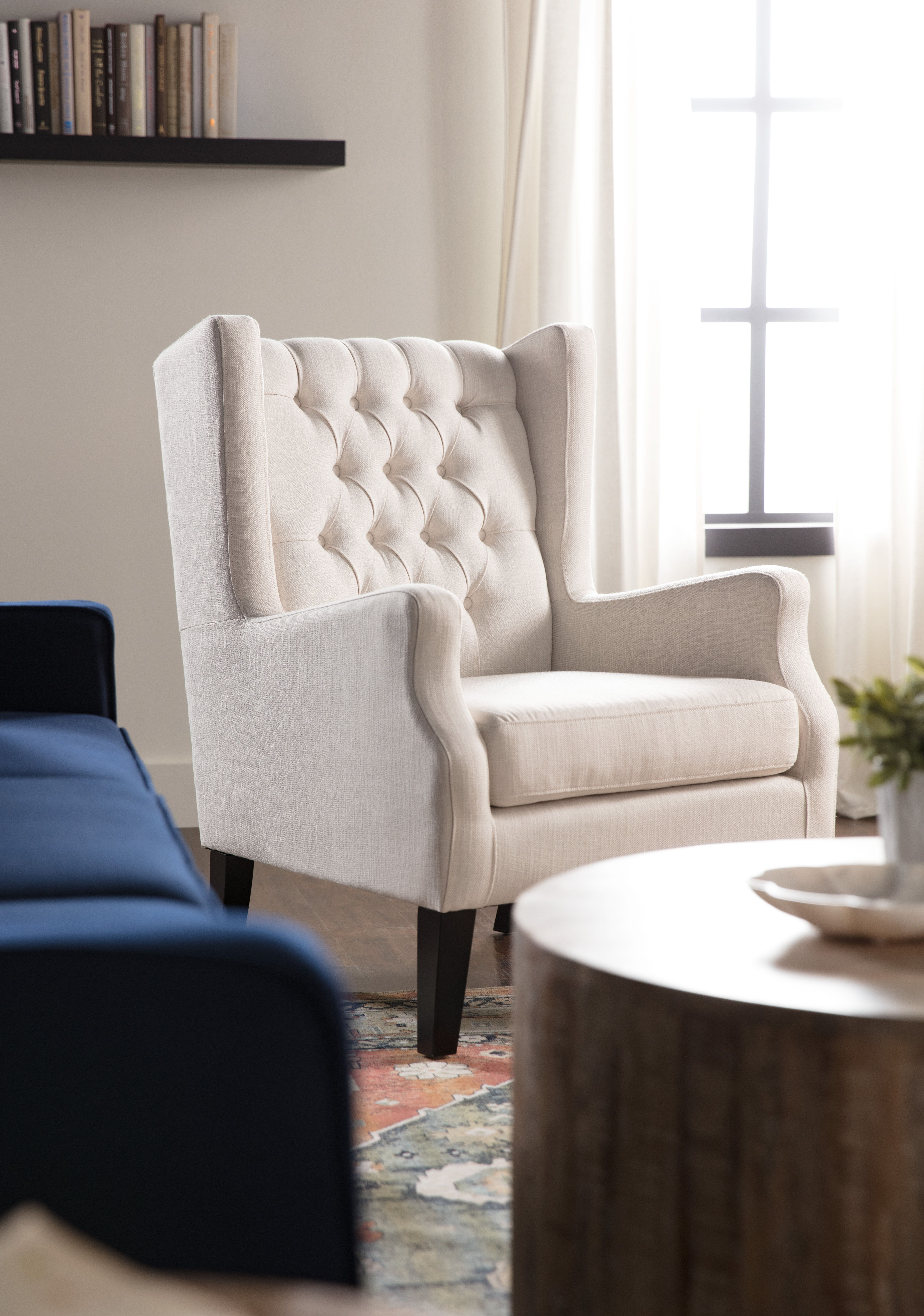 Upholstered Wingback Chair Adds Timeless Elegance To Any Living