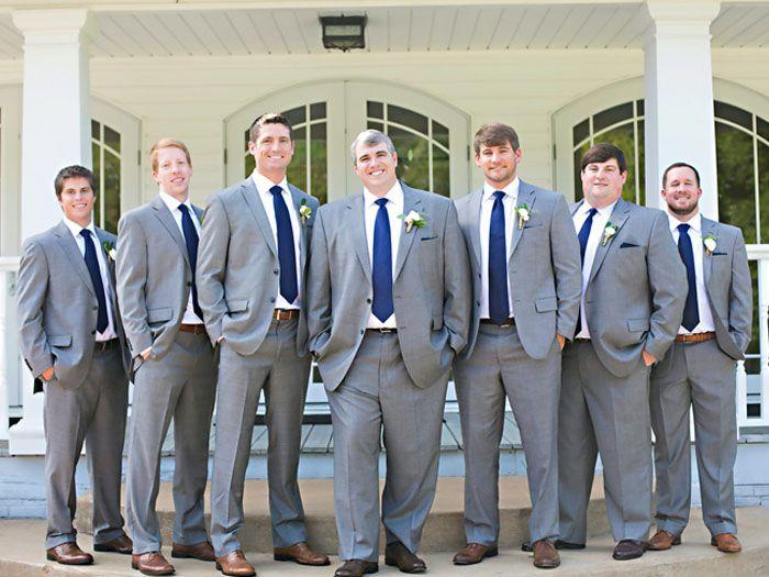 Groomsmen in gray suits with navy ties for summer wedding in ...
