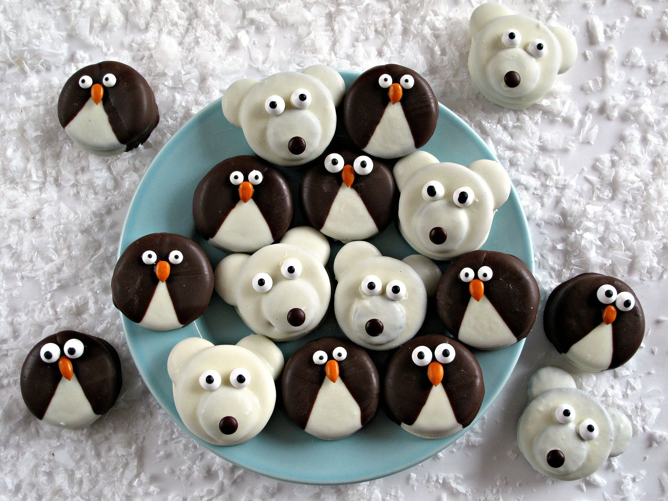 Penguin and Polar Bear Oreos- Delight in a winter themed snack with these adorable chocolate dipped Oreos decorated as penguins and polar bears! Simple instructions included. The Monday Box