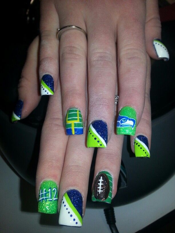Seattle seahawks nail art featuring the team logo 3 d football seattle seahawks nail art featuring the team logo football field goal post and the number polished in the team colors and protected by gel top coat prinsesfo Choice Image