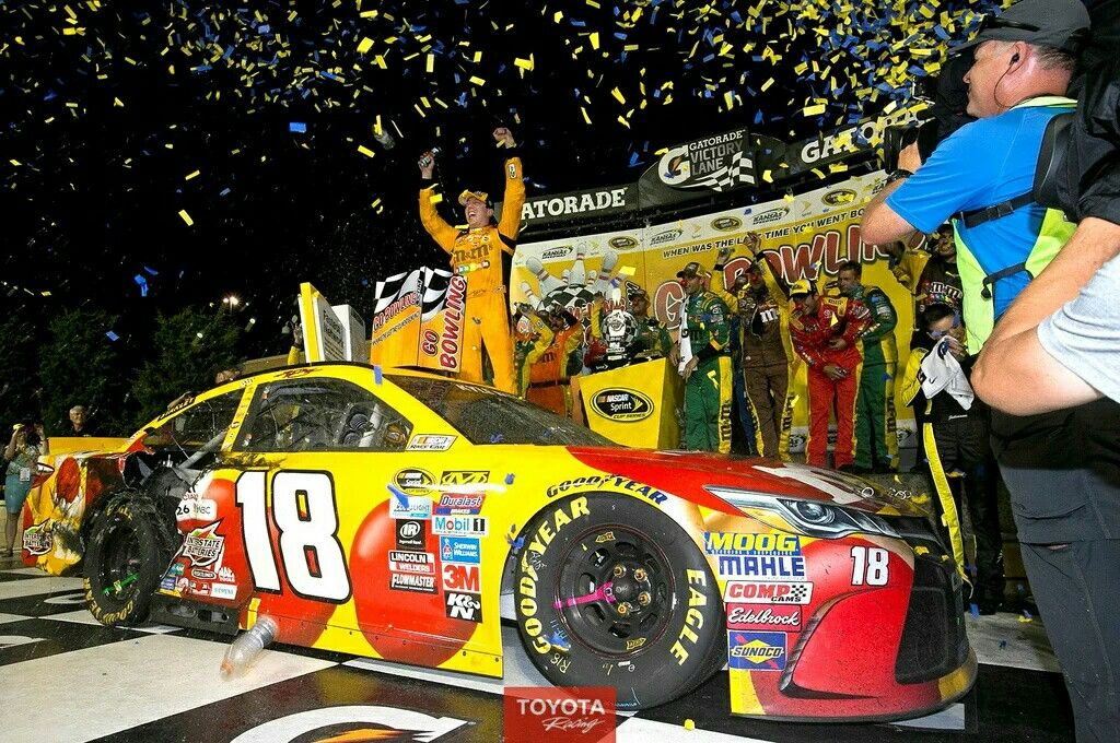 Kyle Busch celebrates his first win at Kansas Speedway and