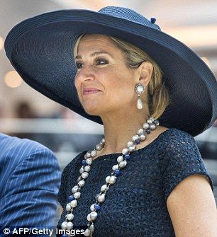Queen Maxima dazzles in a fishtail gown for a glittering royal gala ... 8ad20cb6192d