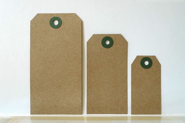 These kraft hang tags are made of 100% recycled material. Available in 3 sizes. Great natural look to packaging and gifts. Would be perfect for reversed stamping projects...such as using white ink!One side has a darker shade than the other - as seen in the second picture.They are 10pt stock with reinforced holes. Unstrung. $3.00