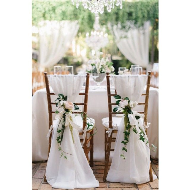 """These #sweetheartchairs look like they're out of a #fairytale! Draped in gorgeous #linens and tied with #roses, we're totally mesmerized by their beauty!…"""