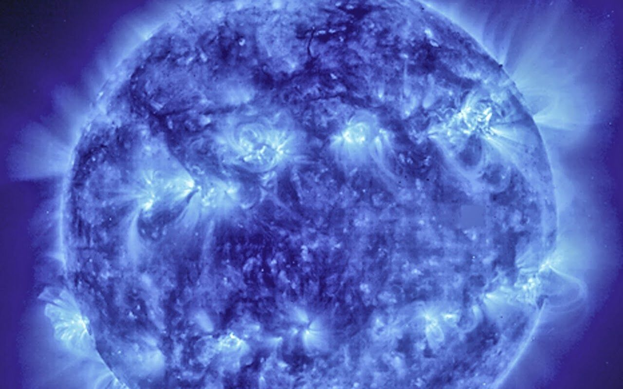 Image of solar activity shows two bright bands circling the Sun. Wow
