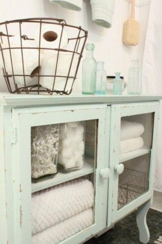 vintage hutch for bathroom! love the vintage egg basket for the toilet paper