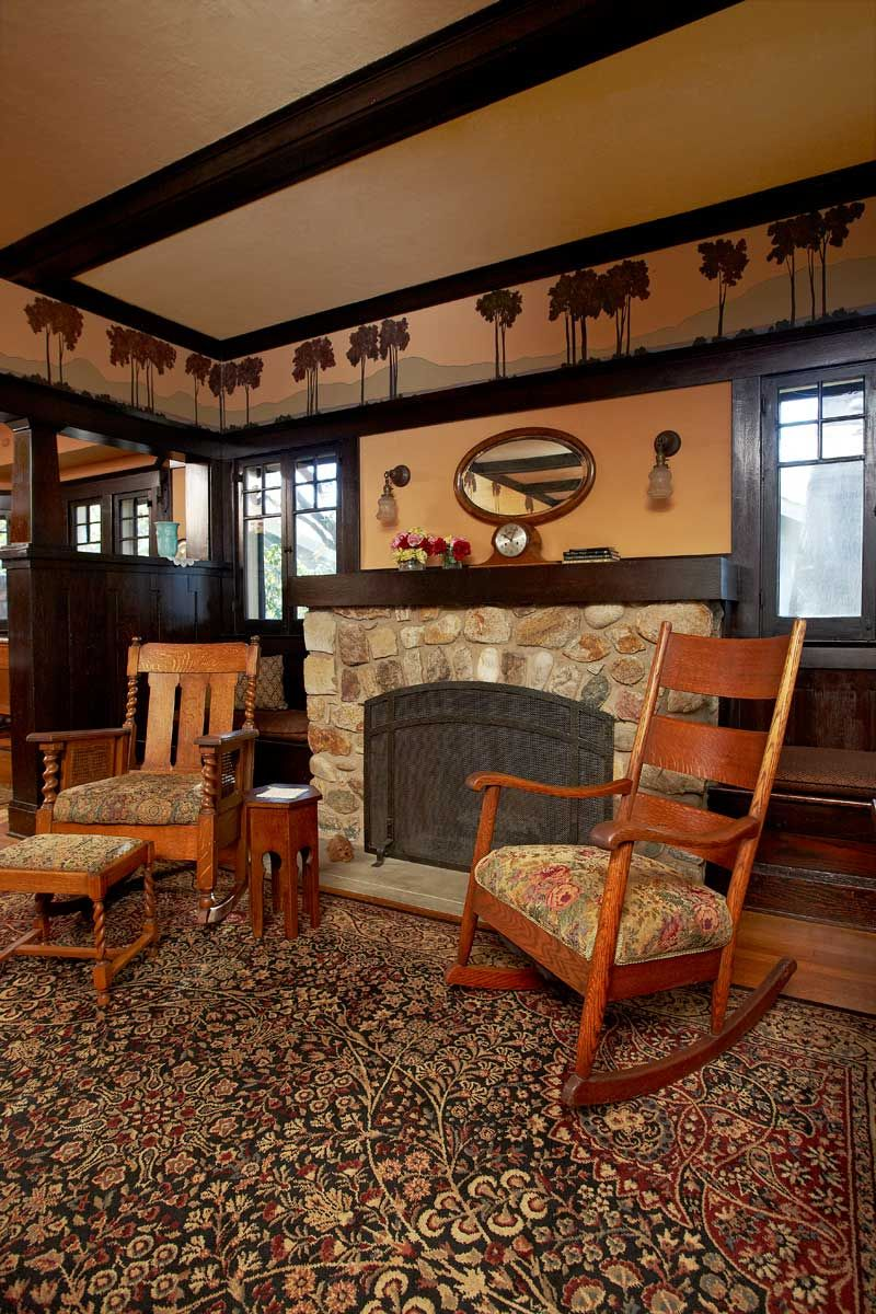 Plan No. 382: A Model Bungalow — Arts & Crafts Homes and the Revival. A stone fireplace anchors the chimney end of the living room.