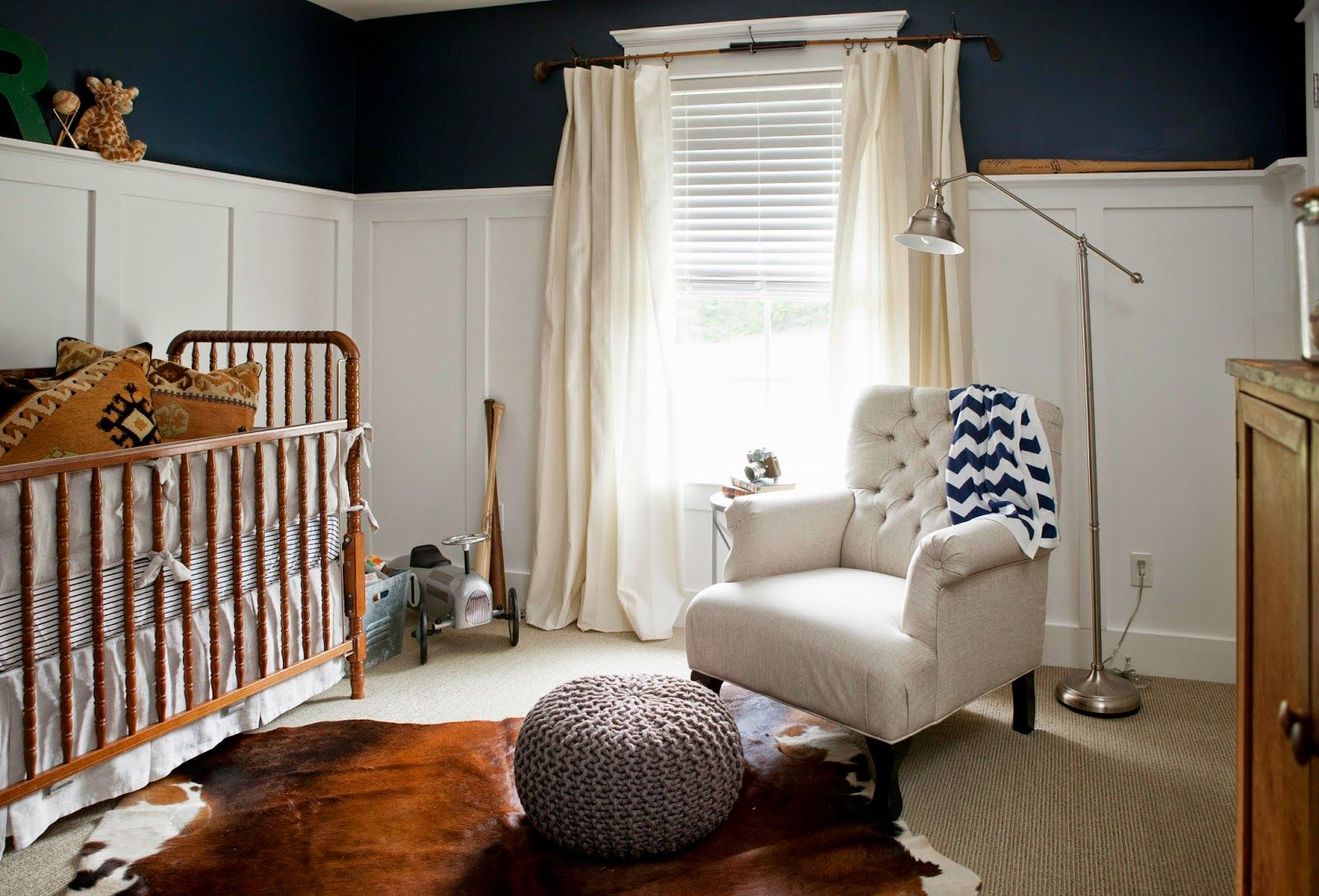 davinci jenny lind crib with cowhide rug and beige ...