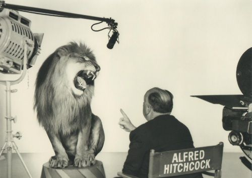 Alfred Hitchcock with the MGM lion, 1958.