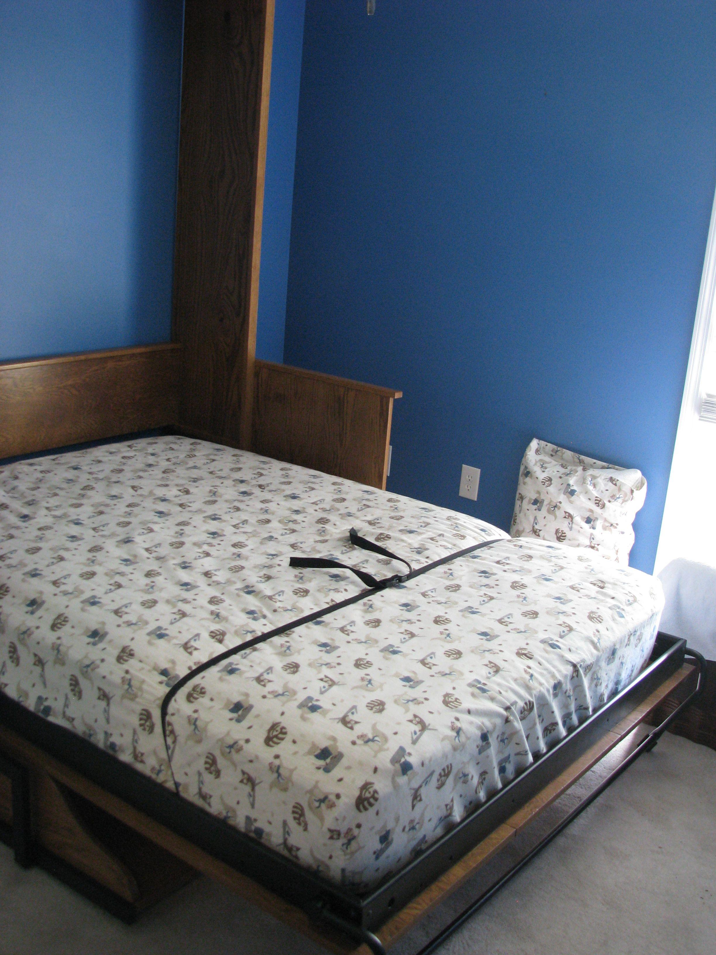 Full size oak Murphy desk bed ready to sleep in. Notice