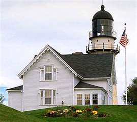 Cape Elizabeth Lighthouse in Maine, also known as Two Lights, is located at the entrance to Casco Bay. The light was originally built in 1828 as two stone towers 300 yards apart. In 1874, these were replaced by cast iron conical towers, each 67' high. The use of the multiple lights was discontinued in 1924. The western light was removed from service and is privately owned. The eastern tower remains in service as Cape Elizabeth Light. Two Lights State Park is named in honor of this station.