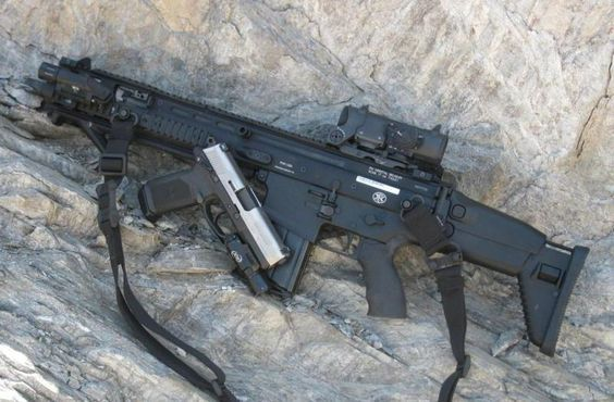 SCAR-H with rail-extension, CQC barrel, and an Elcan Spectre