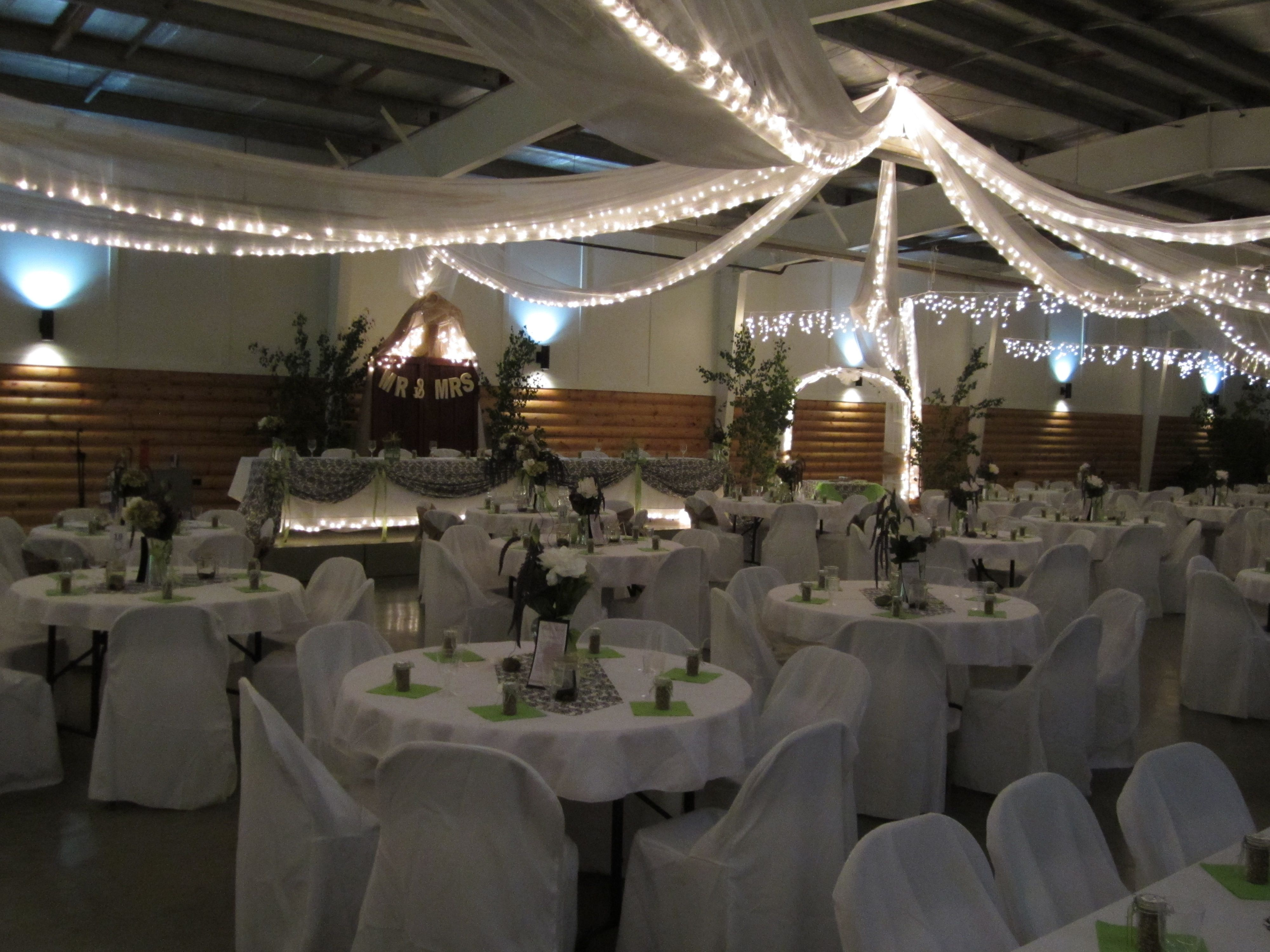 Wedding decoration ideas for hall  the hall had toule hanging yup on the roof with mini lights strung