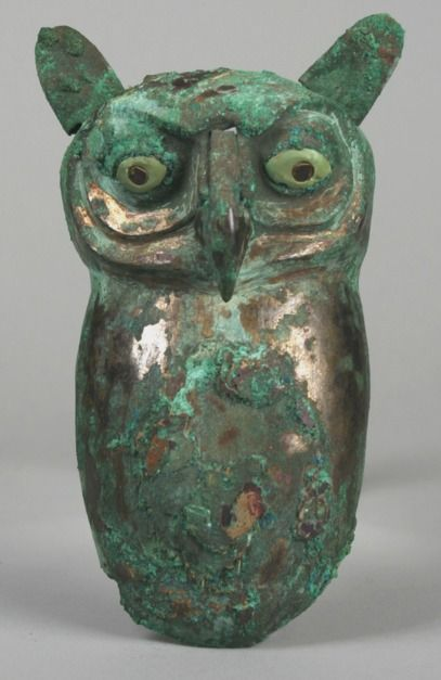 Owl Date: 390–450 Geography: Peru Culture: Moche (Loma Negra) Medium: Silvered copper, shell, pyrite