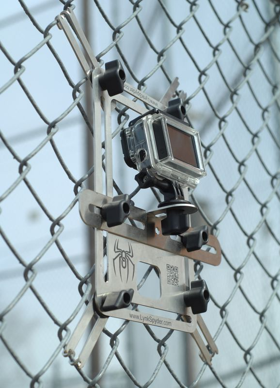 Lynkspyder Mounted To A Chain Link Fence At A Baseball