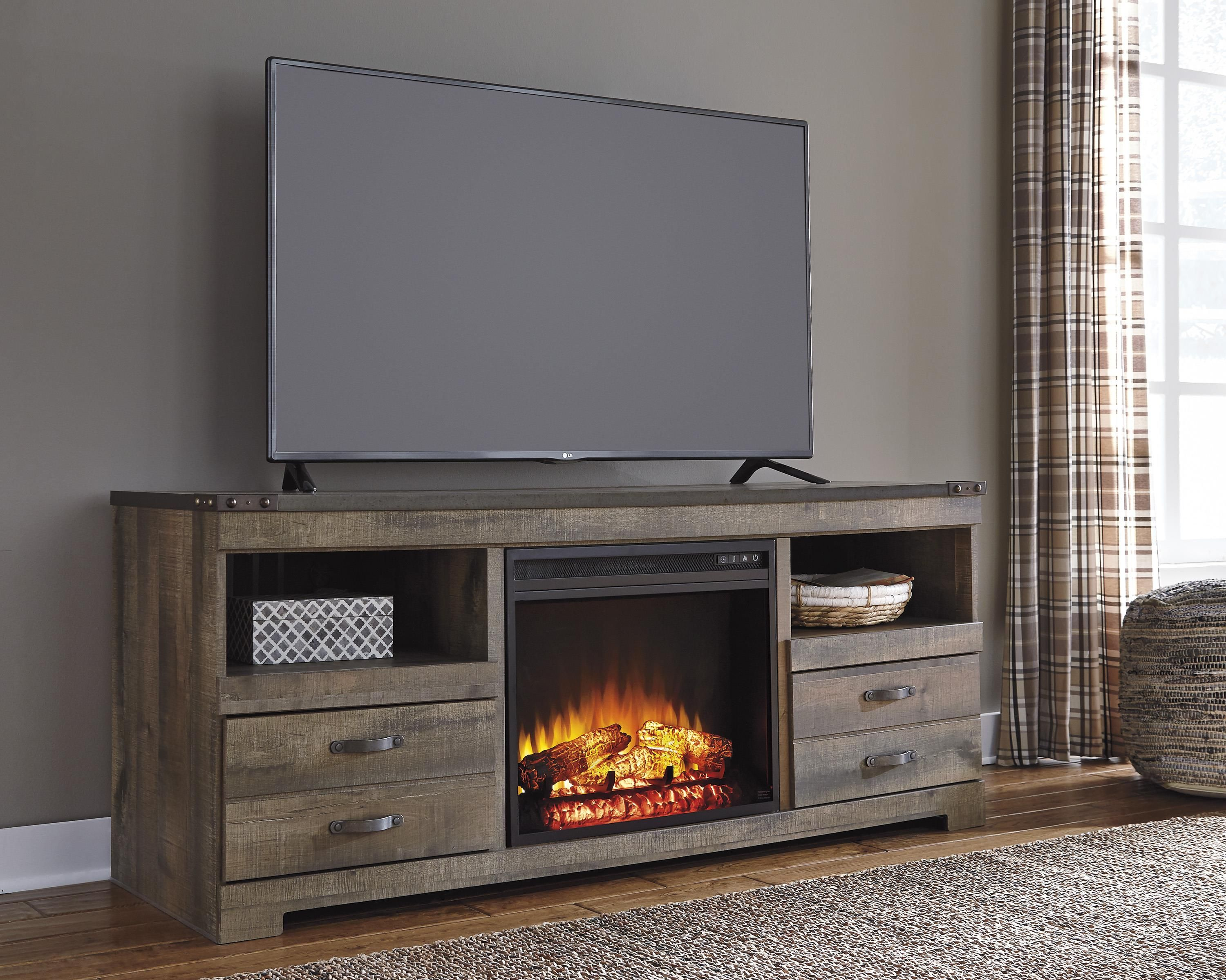 Replicated oak grain takes the look of rustic reclaimed wood on this large TV stand with an electric fireplace insert. Its top metal banding with rivet look at the corners and simple metal drawer hardware amplifies the cool character of the TV stand. Plen