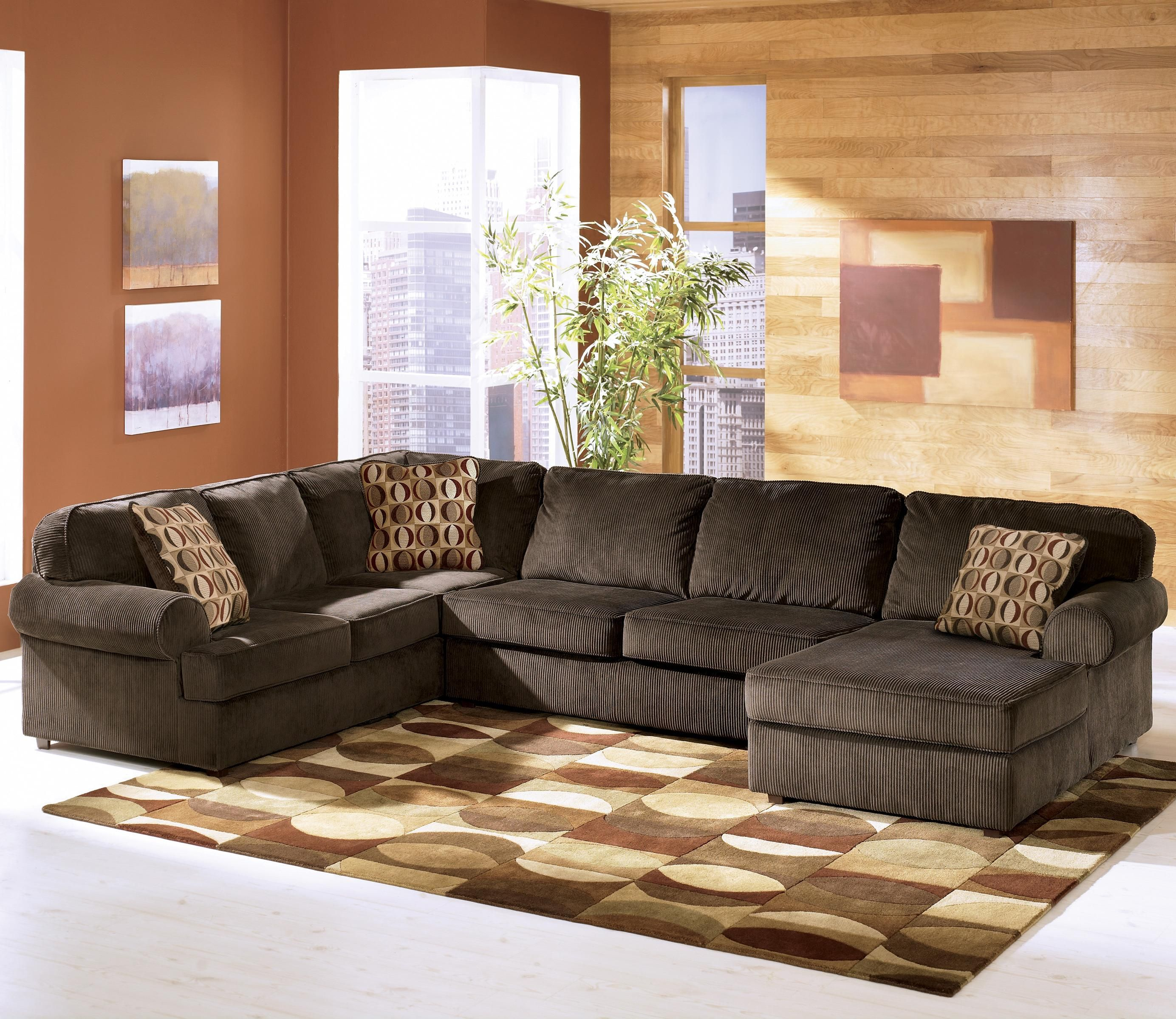 Vista chocolate 3 piece sectional with right chaise by for Ashley furniture sectional sofas chaise