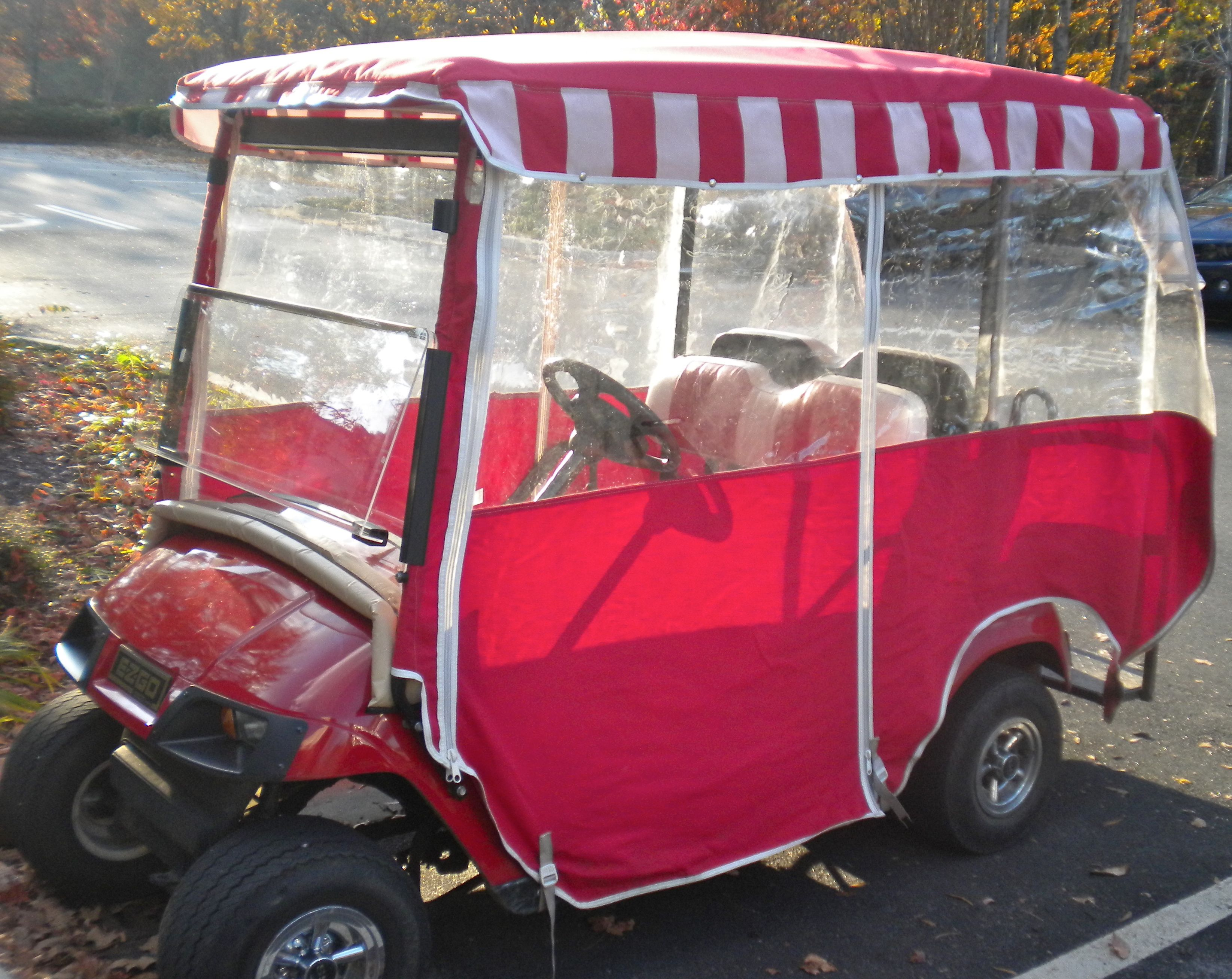 EZGO Golf Cart Accessories for Style, Comfort, & Customizing | EZGO Green Line Golf Cart Sunbrella Cover on national golf cart covers, canvas golf cart covers, classic golf cart covers, golf cart canopy covers, vinyl golf cart covers, star golf cart covers, door works golf cart covers, club car golf cart rain covers, buggies unlimited golf cart covers, clear plastic golf cart covers, custom golf cart covers, discount golf cart covers, sam's club golf cart covers, rail golf cart covers, portable golf cart covers, golf cart cloth seat covers, eevelle golf cart covers, 3 sided golf cart covers, yamaha golf cart covers, harley golf cart seat covers,