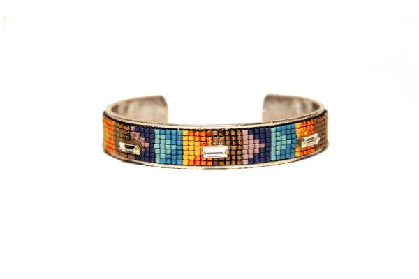 "1/2"" Brass cuff  with hand woven beading adorned with Swarovski Crystals. All beadwork is hand woven by Artisans in Rwanda through a Fair Labor partnership."