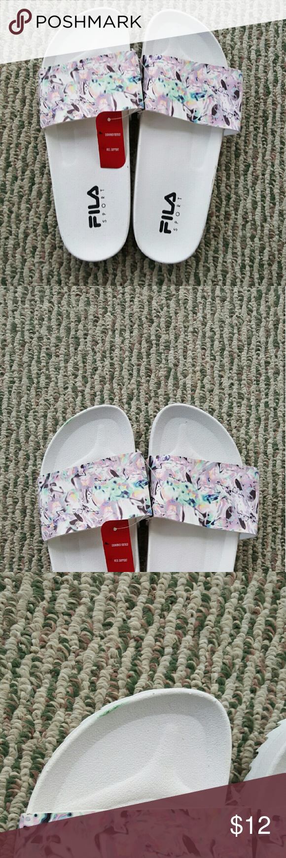 White Fila slides Brand new with tags, white slides from Fila Sport. White bottom with sort of a watercolor print top. Size large 9/10. Small green mark on tip of left shoe. Fila Shoes