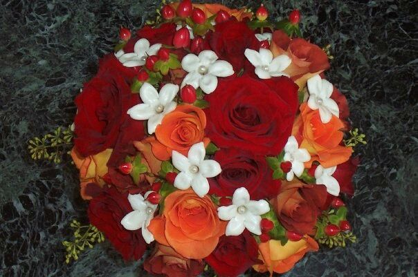 Red, orange and rust color fall bridal bouquet