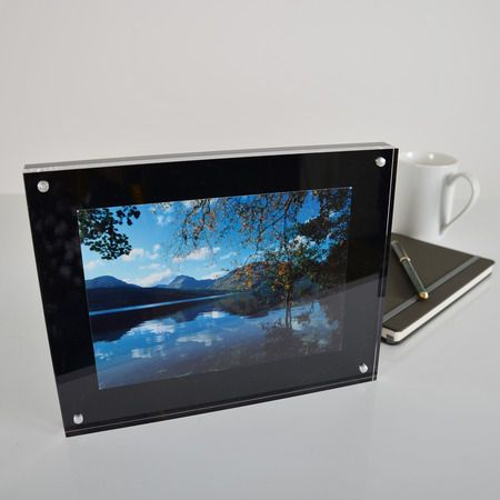 Acrylic magnetic photo frames with a gloss black back panel which ...