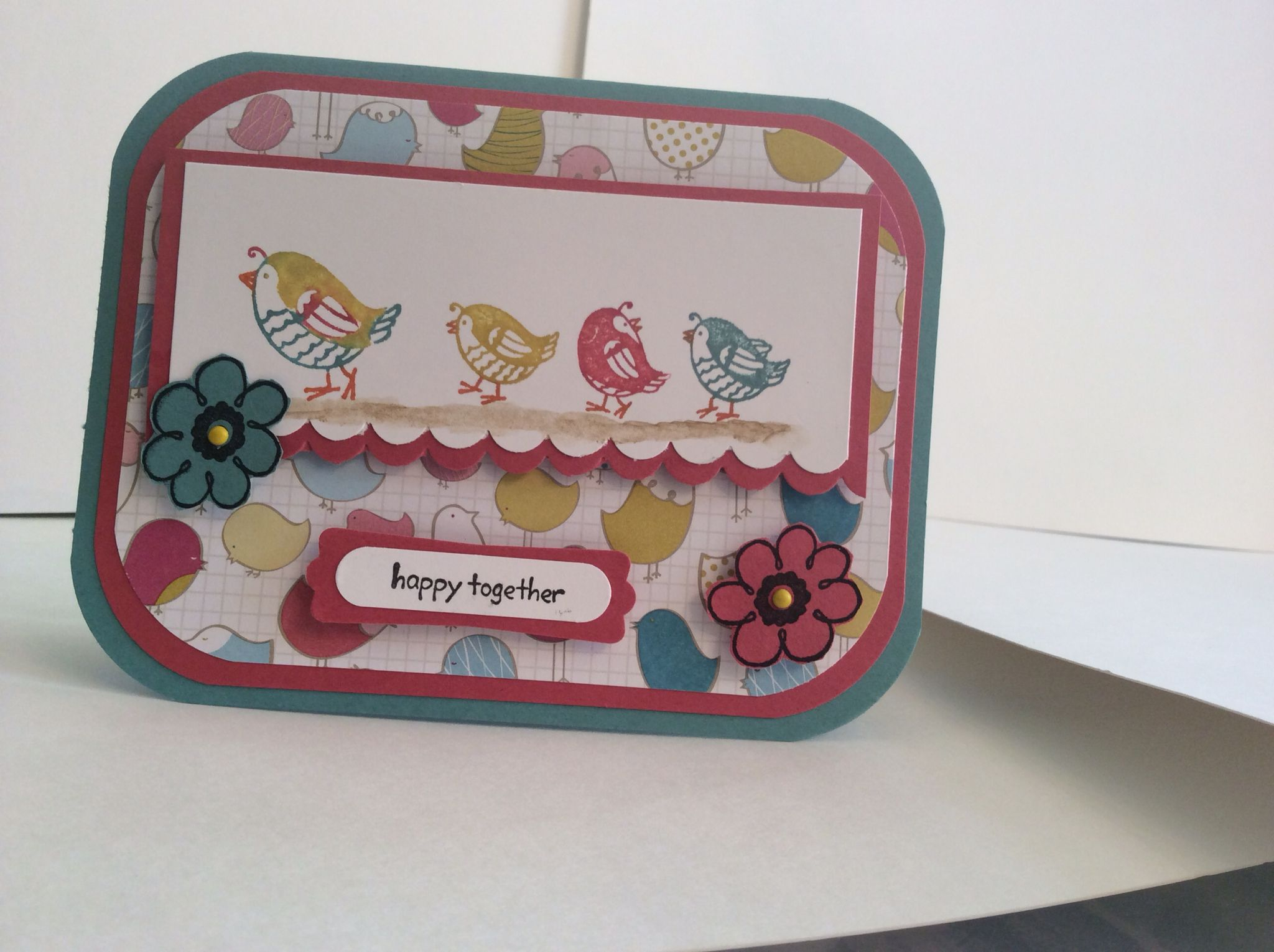 Happy Together by Stampin Up. Used lost lagoon, primrose petals card stock and Birds of a Feather DSP.
