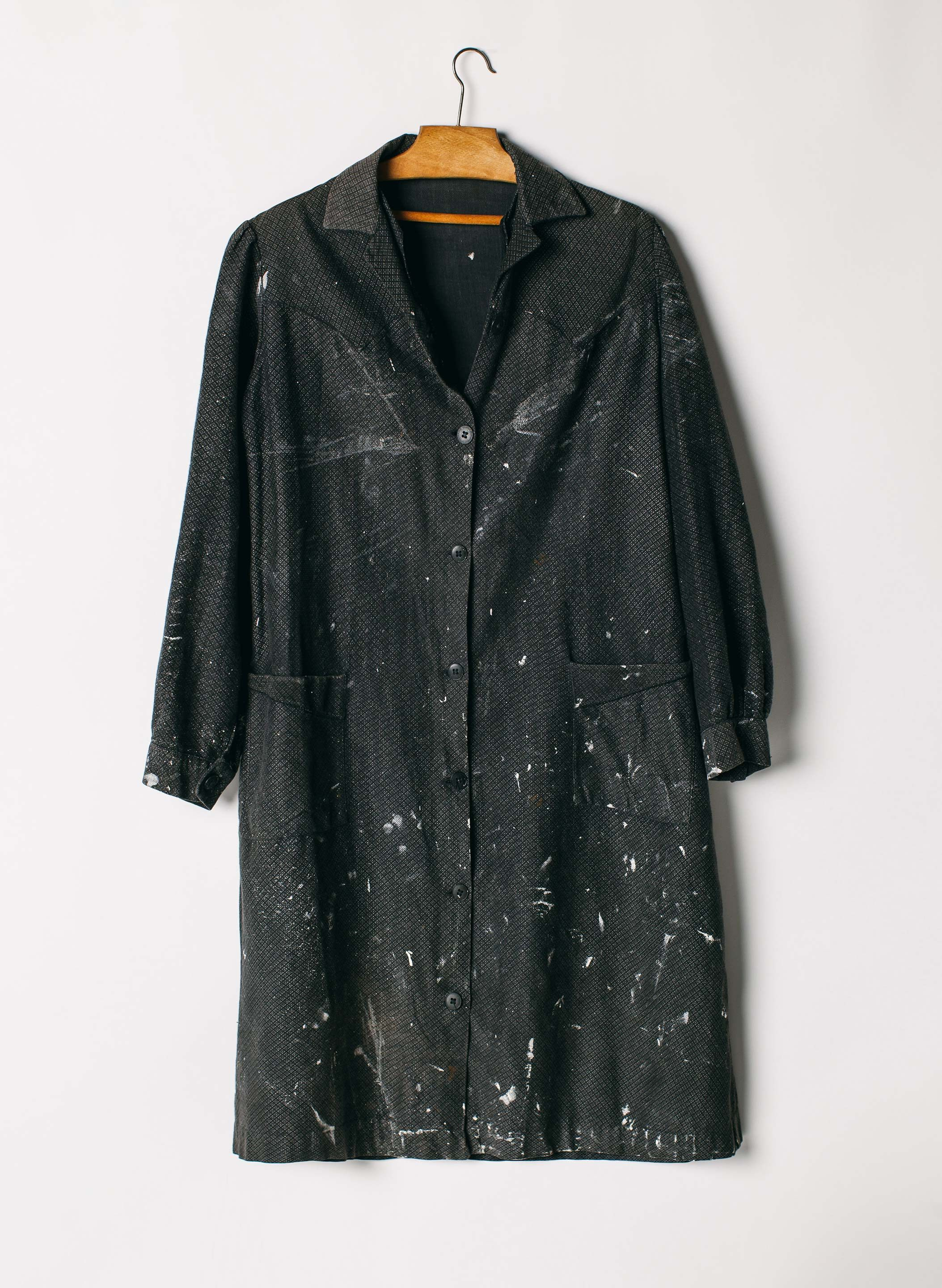 a vintage, paint splattered 1960's painters smock. a relic of the past -  sun faded and beautifully worn with time.