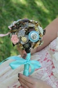 Small wedding bouquet made with old family brooches, jewelry, mementos, and buttons