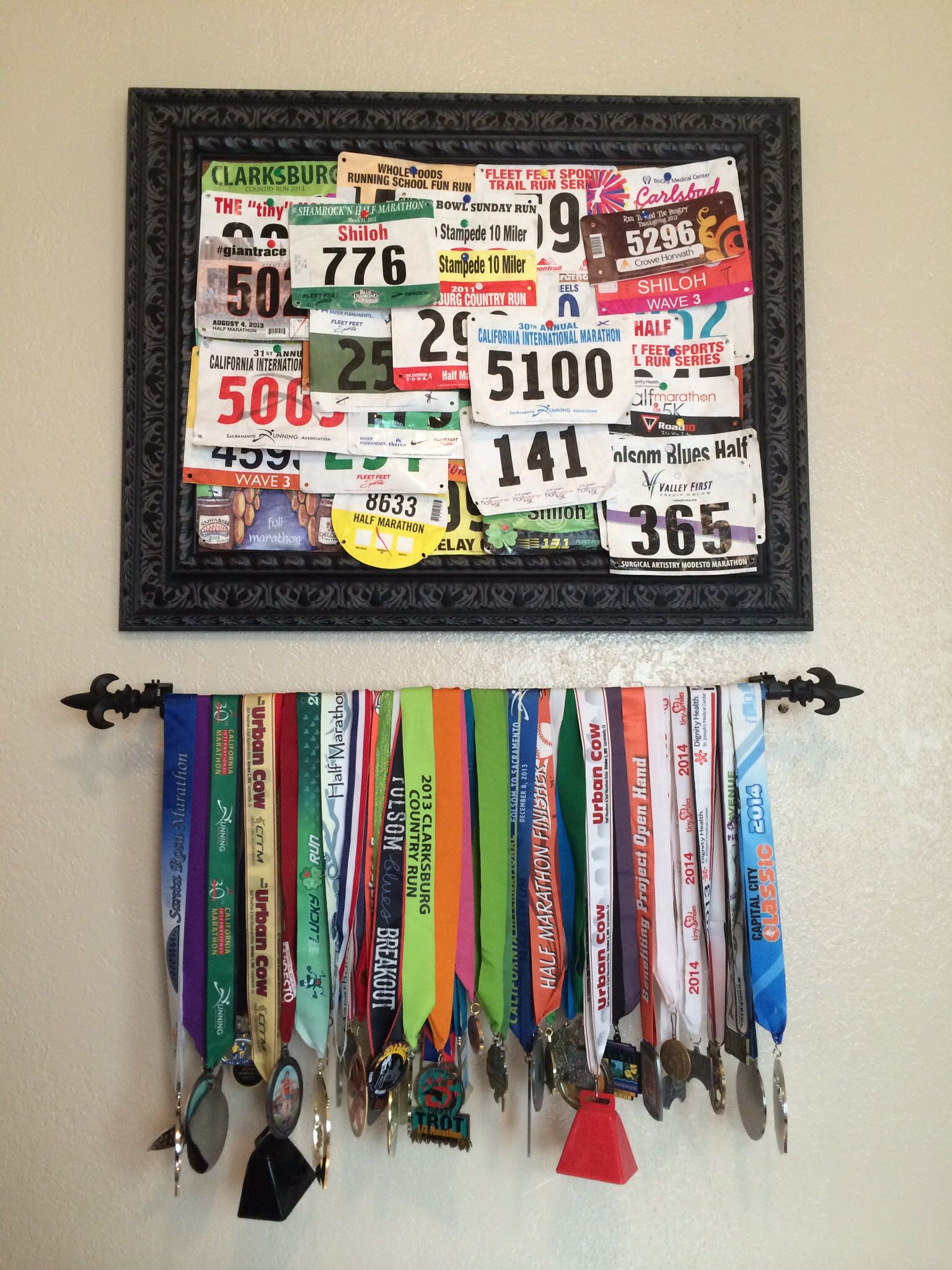 Race Bib And Medal Display Use A Curtain Rod For The Medals And A Framed Cork Board For The