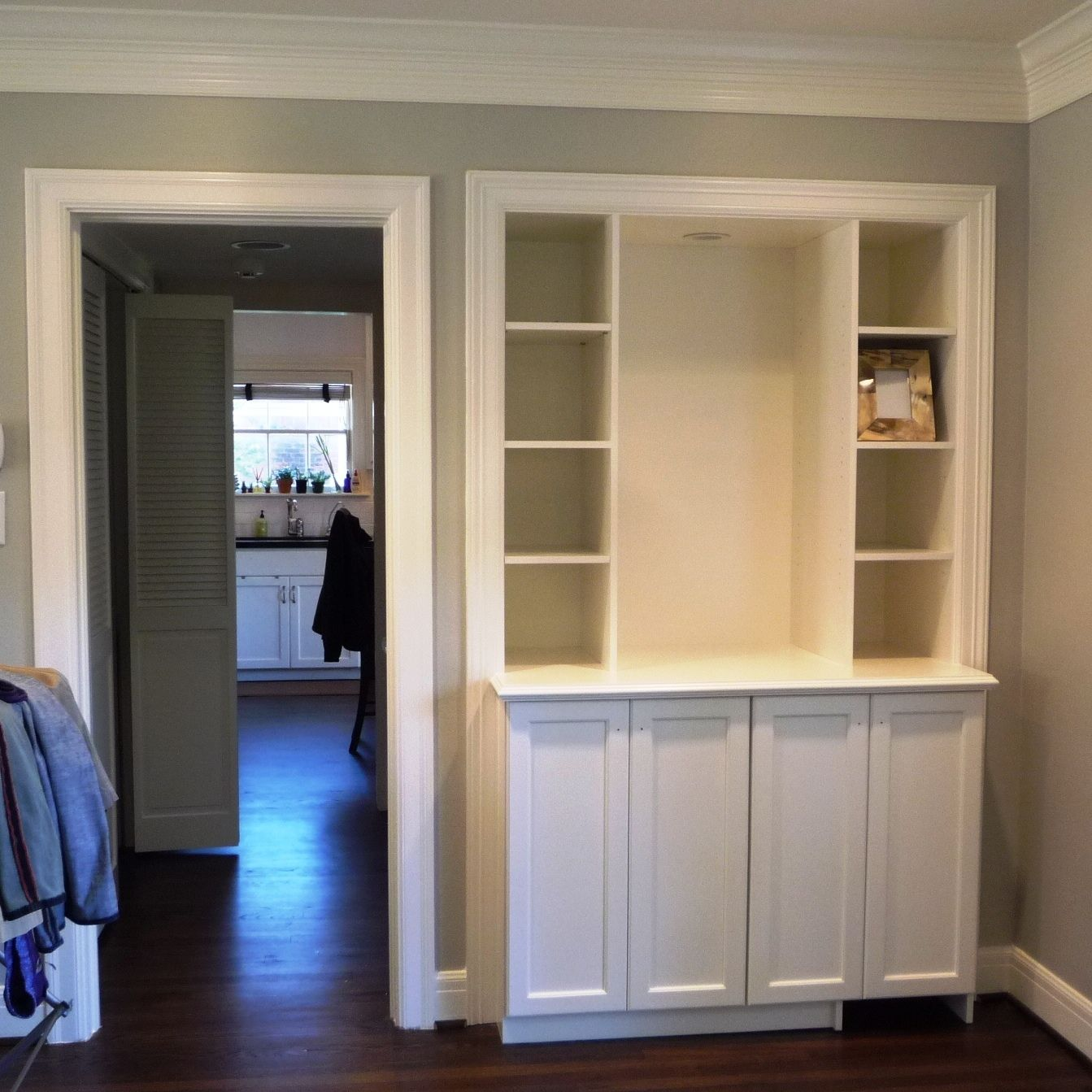 Custom dry bar bookcase built ins installed last week bottom right door has wine fridge - Bar built into wall ...