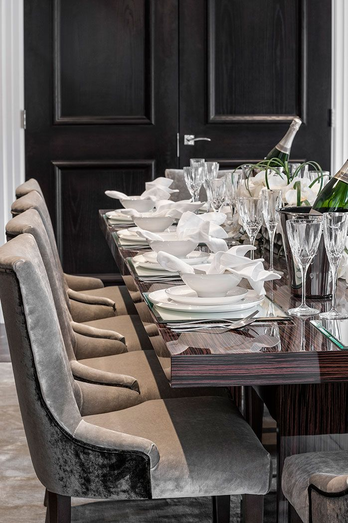 Elegant classic contemporary dining room in subtle tones of grey with  velvet bespoke made dining chairs and ebony Makassar bespoke dining table  designed. Elegant classic contemporary dining room in subtle tones of grey
