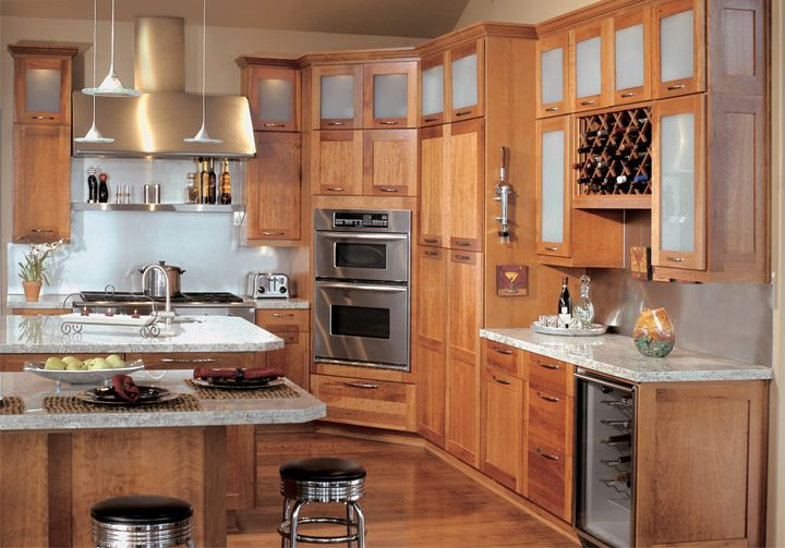 The upper cabinets feature frosted acrylic glass panels ...
