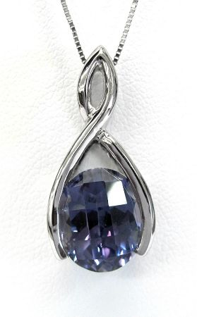 Ladies 14kt white gold gemstone pendant. Mounted in pendant is a created checkerboard oval cut alexandrite gemstone. Pendant comes with an 18 inch white gold chain.