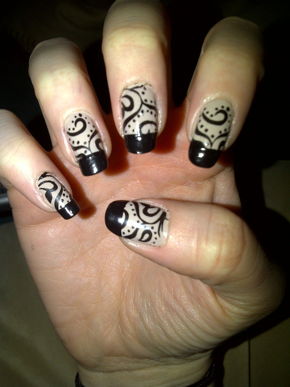 Black And Tan Swirl Design With Black French Tip Creative Nail
