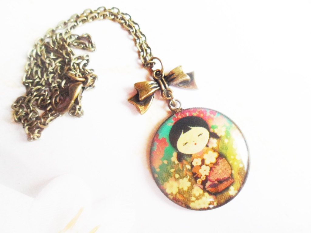 Necklace with a kimono girl pendant and a bow vintage style brass