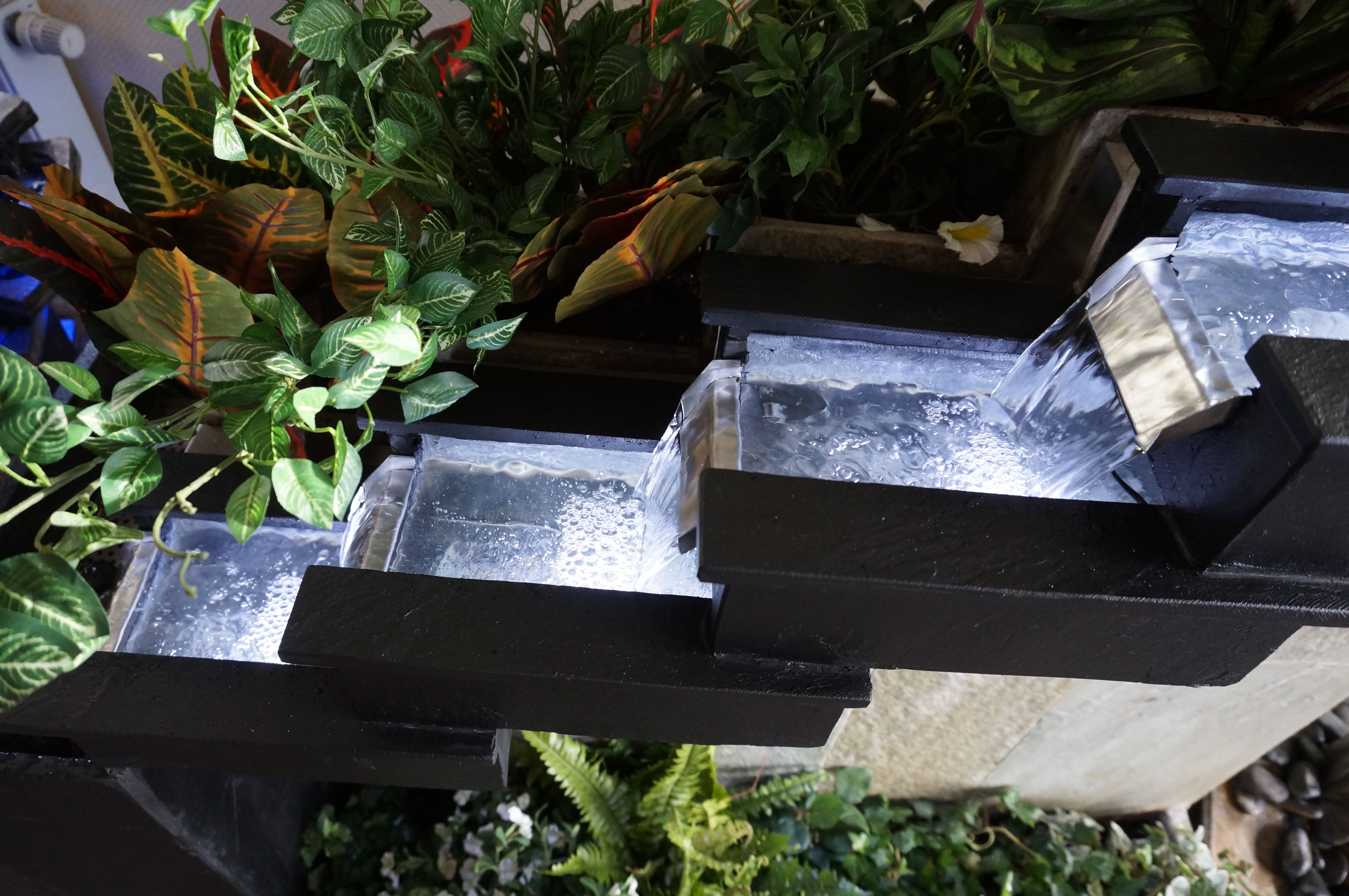 """Amazing waterfall from Cactose's """"Babylone"""" fountain. This fountain is made of natural stone and can contain many plants. A real garden for the house or the terrace ! www.cactose.fr"""