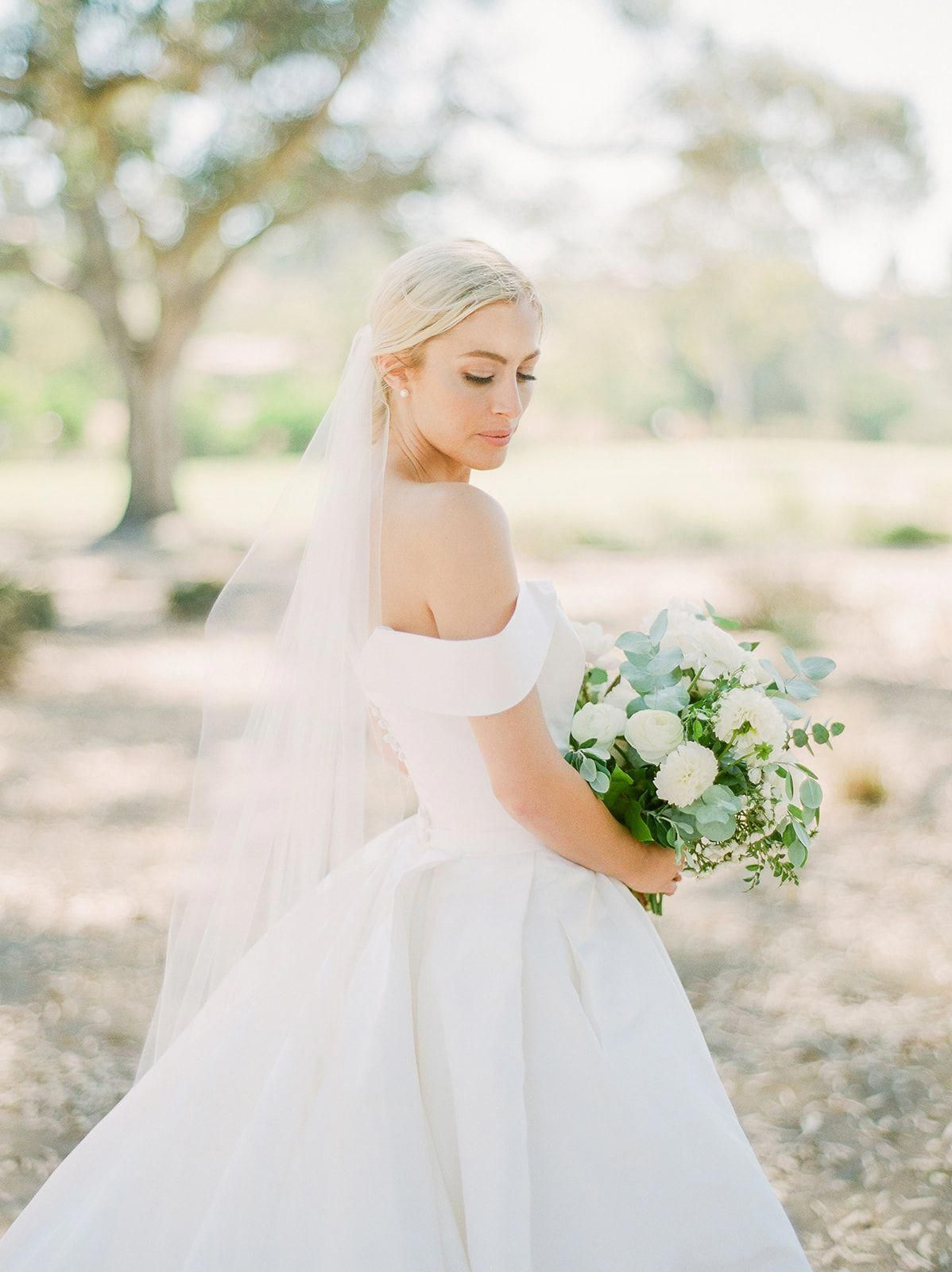 Classic Off Shoulder Wedding Gown And Lush White Green Bouquet