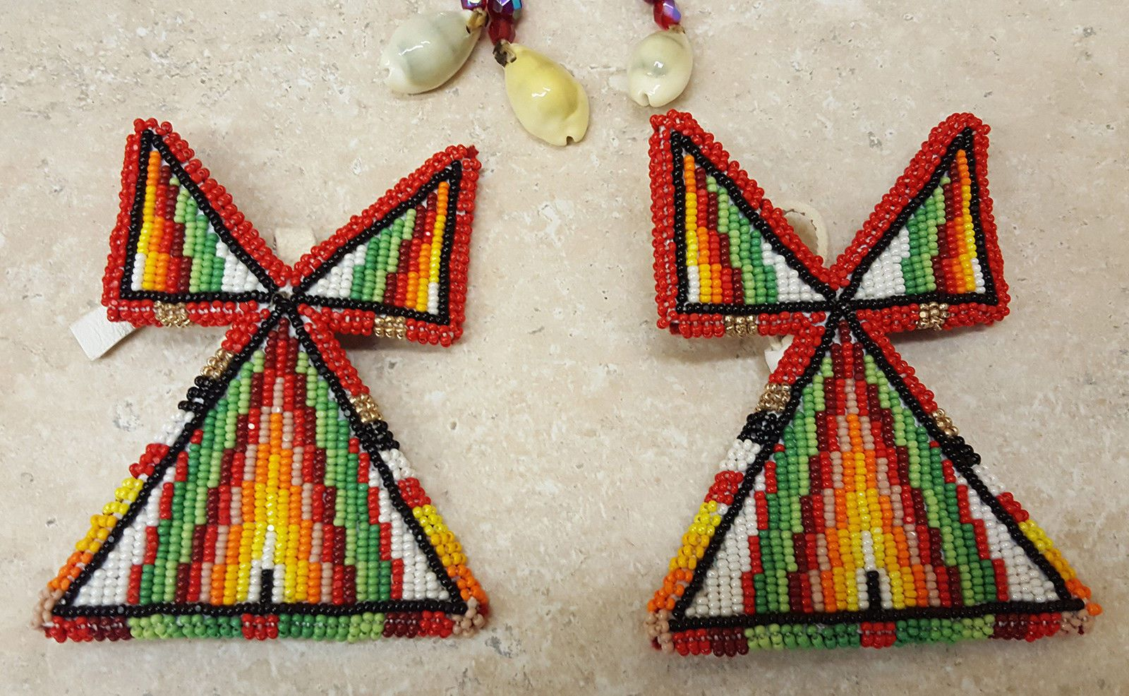 This nice handmade 3 piece beaded Native American Indian tipi design dance set features a large beaded rosette necklace and a pair of matching beaded hairties. The pieces are beaded with small round beads. | eBay!