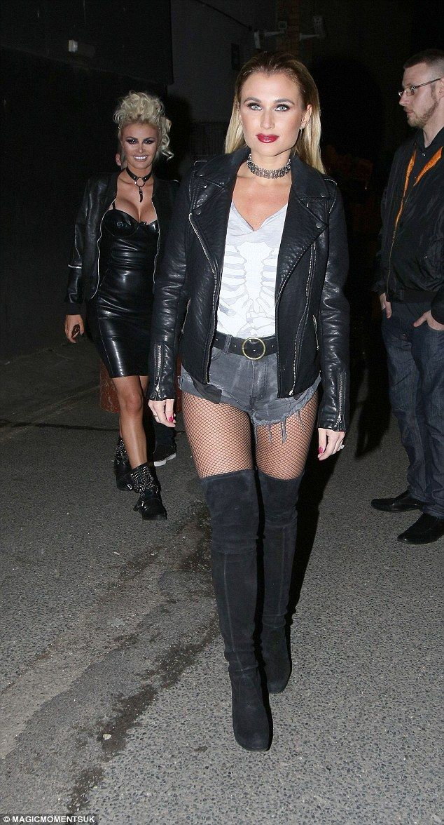 Rock on! Billie meanwhile looked every inch the rocker in her skimpy denim which she paired with thigh-high boots featuring a teetering heel