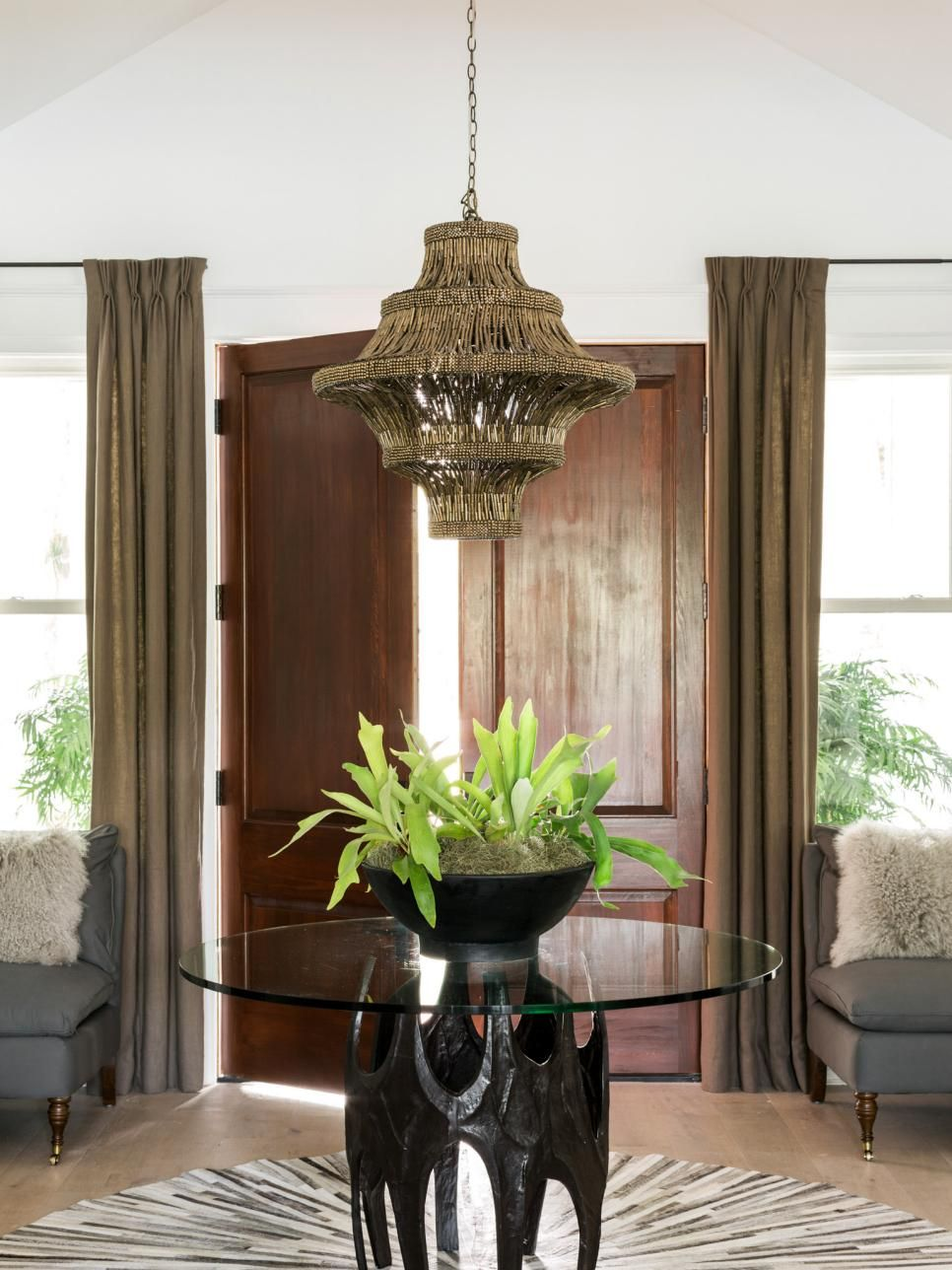 A tasteful foyer creates a grand entry that greets guests as they enter the house and transition to the main living areas of this home that takes Southern style and makes it fresh, young and new.