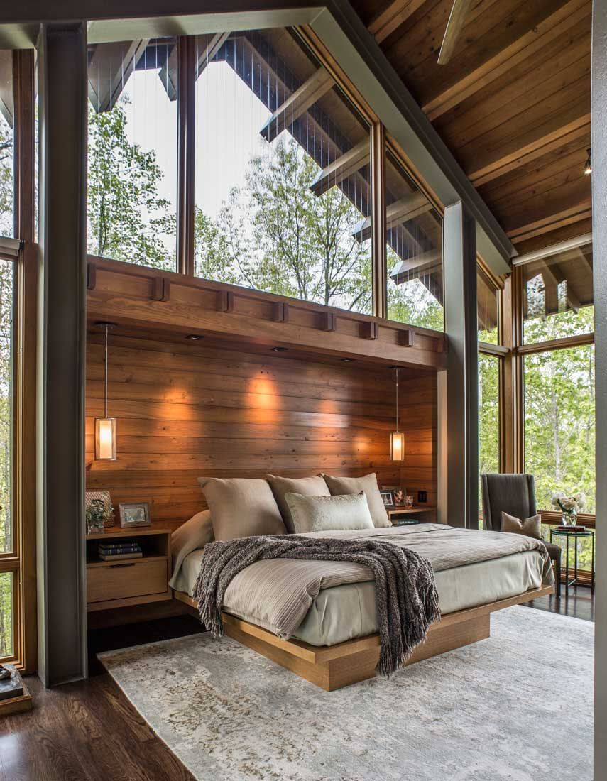 North Carolina mountain home feels like living above the treetops #mountainhomes Carlton Edwards designed this contemporary mountain home sited in the Balsam Mountain Preserve, a community in Jackson County, North Carolina.