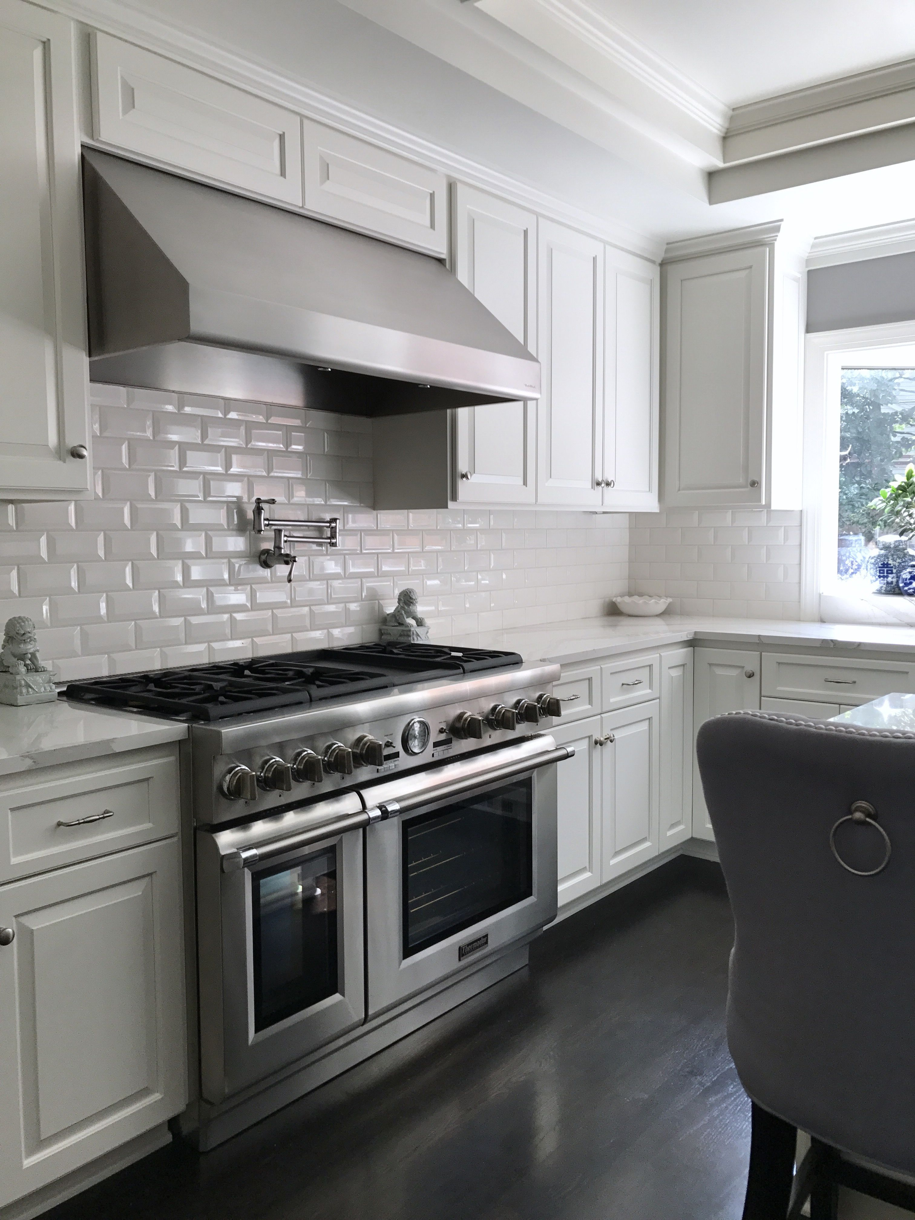 Newly remodeled white kitchen thanks to the dream team of